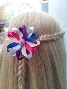 Inverted fishtails around the side joined in the middle with a cute handmade clip ♥