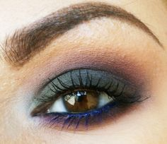 gorgeous multi color smokey eye, with bright blue mascara on underlashes