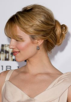 Dianna Agron's loose bun with bangs and volume, side view