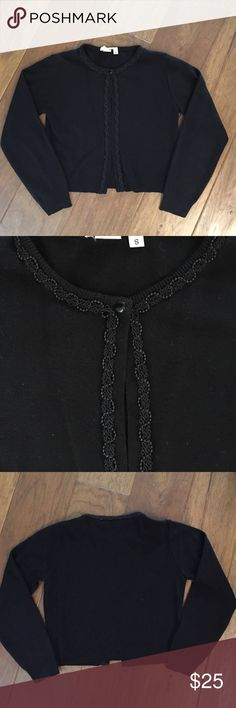 """Little Black cardigan sweater with beading trim. Great sweater to wear with dresses or pants. Single top button. Beading along neckline and front opening. Brand name was cut out because it itched my neck so not sure what the brand is.  100% Acrylic. In great gently used condition. Length - 18"""" from shoulder to bottom. Beading in excellent condition. Sweaters"""