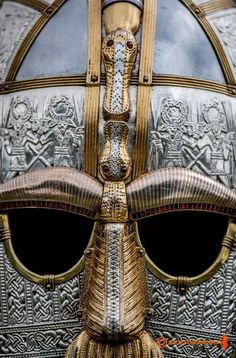 The Sutton Hoo Helmet - the warriors are seen in the silver plating and the gold playing on the nose and eyebrows is a Dragon.