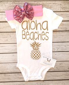 Baby Girl Bodysuit Aloha Beaches Bodysuit Girls Shirt Aloha Beaches Shirts Beach Shirts Baby Shower Aloha Beaches  Our bodysuits are a huge hit! Great baby shower gifts & are great for photo shoots! *****HEADBAND NOT INCLUDED IT MAY BE PURCHASED IN THE DROPDOWN SELECTION BAR RECOMMENDED FOR 3 MONTHS AND ABOVE  *****YOU MUST SELECT LONG SLEEVE AT CHECKOUT IF YOU WANT LONG SLEEVE  Be sure to wash inside out. Hang dry or dry inside out on low heat. That is to protect the glitter/vinyl from…