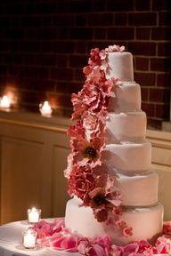 Gorgeous cascading pink floral wedding cake