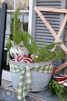 Fun Christmas Decorating idea: Galvanized bucket with ornaments and greens from Finding Home's FrontPorch