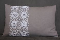 Grey pillow with crochet lace