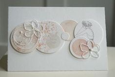 handmade greeting card ,,, soft pink and gray on white ,,, grouping of die cut cirlces with a pair of line art die cut flowers ... lovely ....