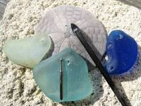 "How to drill holes into beach glass. This will come in handy for making the beach glass wind chime that was, for me, the highlight of the movie ""The Descendants."""