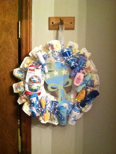 Diaper wreath - love this with all the extra stuff