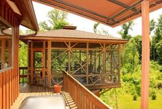 Tropical Deck with Beacon Rhodes Flush Mount Indoor - Outdoor Ceiling Light, French doors, Transom window