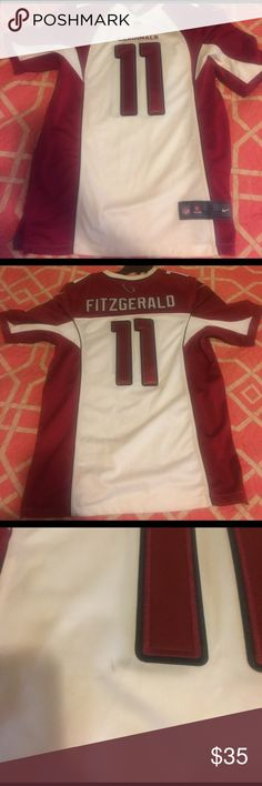 Men's S AZ Cardinals jersey Small men's Arizona Cardinals Fitzgerald jersey. Never worn. A few small black marks that would probably come out after being taken to a dry cleaner. NFL Shirts Tees - Short Sleeve