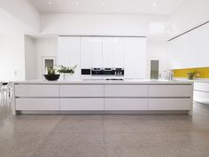 This huge Pure White Caesarstone kitchen island provides serious food preparation space.  We love the push-touch drawers too. www.caesarstone.co.za