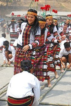 Cheraw folk dance from Mizoram, India- boys maneuver bamboo sticks rhythmically and girls step and dance!