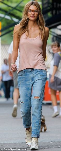 Specs appeal: Jessica was seen keeping it casual in large glasses, ripped jeans, a tank top and Converse trainers as she went for a walk wit...