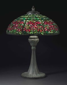"** Tiffany Studios, New York, Favrile Leaded Glass and Patinated Bronze ""Double poinsettia"" Lamp."