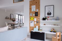 Scott's play corner consists of several IKEA elements like the shelves and storage bench.