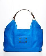 """Luxe Leather City Bag - Crafted in luxurious leather in an array of spring colors, this softly structured bag is a take-everywhere essential for the season. Leather buckle strap. Front pocket with metal button detail. Roomy, lined interior. 10""""H x 20""""W x 8""""D."""