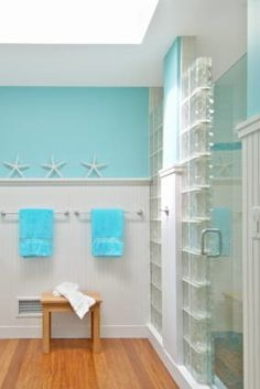 This fun nautical theme and glass block and frameless shower door really create an open feeling for this shower. Lots of light and a fresh look - learn more -  http://innovatebuildingsolutions.com/products/glass-block/glass-block-shower #glassblockshower
