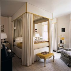 Veere Grenney ~ master bedroom's four-poster designed by Veere Grenney as are the carpet and white linen walls in his London townhome.