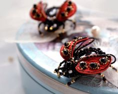 Luxurious, exquisite and femine Designers jewelry - Beetle brooch. The brooch will perfectly complement your unique jewelry collection or will be a wonderful gift to a very special person.  Beautiful, hand-embroidered Beetle with delicious wings - for your special day from my collection INDIA.  A beetles body tightly and neatly hand-embroidered on imitation of leather using Czech crystals, seed beads and sequins, in the middle - Rose Quartz. Beetles wings is made of organza and tulle…