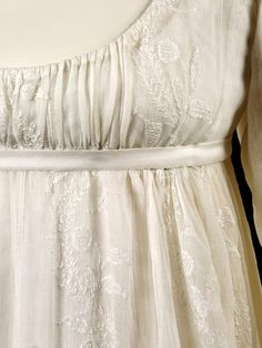 Embroidery detail from muslin gown, ca. 1800, in the Victoria and Albert Museum.