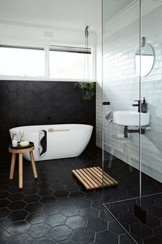 Awesome 10 Magnificent Black Bathroom Floor Tile Ideas To Make Your Activities Comfortable Are you looking for ideas for your bathroom floor? The selection of the right bathroom floor not only makes activities in the bathroom more enjoyable . Black Bathroom Floor Tiles, Modern Bathroom Tile, Diy Bathroom, Black Tiles, Bathroom Tile Designs, White Bathroom, Bathroom Interior Design, Bathroom Flooring, Small Bathroom