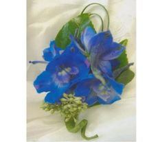 This striking Blue Delphinium Boutonniere would look great in your pictures!
