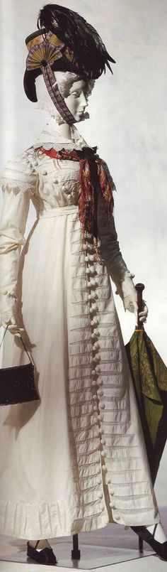 Pelisse- Women's fitted cloak with set-in sleeves and Empire waist. This style was inspired by military clothing. Initially, they were made with fur linings but soon after, they were made entirely with silk.