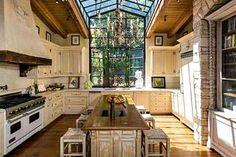 Jennifer Lopez Kitchen. Love the skylight and community table!