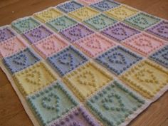 This Knit Heart Squares Baby Blanket Pattern is absolutely the sweetest pattern to make for baby's nursery! Get the pattern here, plus learn a new stitch!