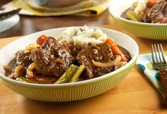 These melt-in-your mouth short ribs are the ultimate comfort food.  They slowly braise in a splendid red wine-beef stock sauce until the meat practically falls off the bone.