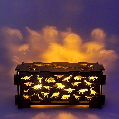 Dinosaur wood childrens night light box lamp trinket storage box in sustainable wood. $89.00, via Etsy.