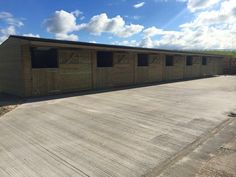 L Shape Stable Block with 3 Stables - Finer Stables Shiplap Cladding, Roof Joist, Hay Barn, External Lighting, Front Windows, Roofing Systems, Roof Light, Brickwork