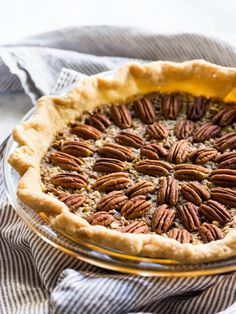 This is the best pecan pie recipe I have ever tried. There are pecan halves and crushed pecans in every bite. The homemade crust is perfect too! | www.ifyougiveablondeakitchen.com