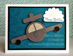 "Stampin' Up! Punch Art by Sweetest Designs: Wyatt's Punch Art Stamps: Create a Cupcake Ink: Island Indigo CS: Basic Black, Basic Gray, Island Indigo, Sahara Sand, Whisper White Accessories: Big Shot, retired cloud textured embossing folder, scallop circle punch, Own punch, 1/2"" circle punch, word window punch, 1-3/4"" circle punch"