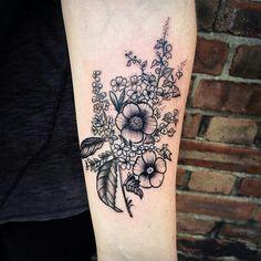 Pretty botanical flower tattoo by Rebecca Vincent