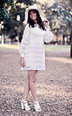 A circa 1970's Long and transparent sleeve cream toned lace empire line mini wedding dress. Wedding dress and photo Vintachic