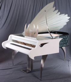 I recently bought this piano and love it,, http://pinterest.com/cameronpiano