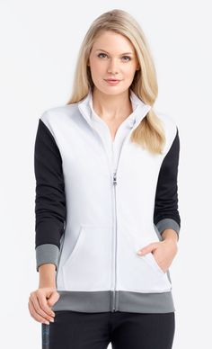 If you're in the market for some new outfits, consider our women's apparel! Shop this comfortable and stylish White Multi EP Pro Ladies Essentials Water Resistant Color Block Golf Jackets from Lori's Golf Shoppe.