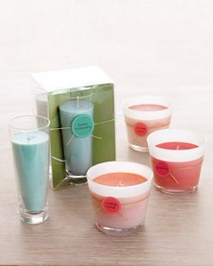 Scented Soy Votive Candles-A collection of winter-themed pillar candles or softly scented votive candles is a gift that will make any hostess beam. www.marthastewart.com