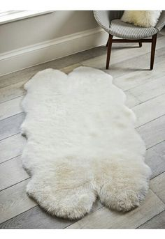 Made from sumptuous, supersoft sheepskin that has been carefully manufactured in the UK, this large soft white rug is comprised from four pieces of natural sheepskin, beautifully stitched together on the reverse. A luxurious skin perfect for by Cox And Cox, White Rug, Large Rugs, Kids Bedroom, Shag Rug, Ivory, Indoor, Living Room, Quad