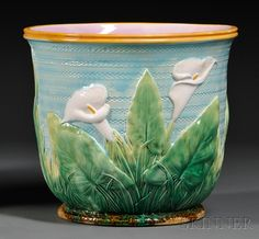 George Jones Majolica Calla Lily Jardiniere, England, late 19th century, decorated in low relief on a textured roulette turquoise ground with a yellow rim, impressed and pad mark, ht. 10 1/2 in.     SOLD $300