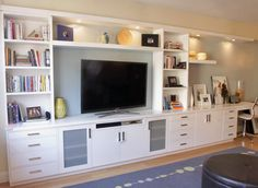 the living room was in need of a great deal of storage as well as a wall