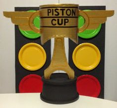 In preparation for my son's Disney CARS themed birthday party, I built a Piston Cup for a centerpiece.      Here's how:   MATERIALS  - plas...