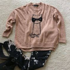 """TOPSHOP Masked Cat sweater Super cute TOPSHOP Masked Cat sweat. Color is a pinky mauve with black detail. Hi lo styling (only slightly). Approx 25"""" shoulder to hem in front, 26.5"""" in back. Laying flat approx 24"""" pit to pit.  UK size 10, US size 6. 44 acrylic 43 nylon 13 mohair. Excellent condition. Topshop Sweaters Crew & Scoop Necks"""