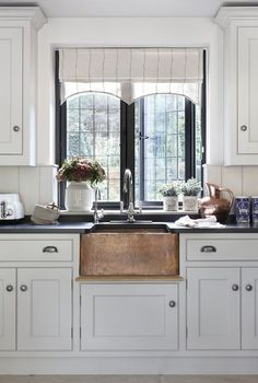 I love the gothic vibe and drama that comes with a Tudor-style house. This home in Hertfordshir...