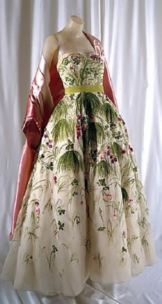 "1953 Dior ""May"" evening dress. Strapless fitted bodice and full long skirt. Ivory with green and pink spring floral. Designed with pink satin wrap. Photo: The Metropolitan Museum of Art"