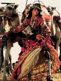 """A gypsy caravanning we will go, wheels clattering on the dirt roads of South America. We'll wind the women's wares around us, great bright bolts of fabric and poms and fringe, and pay them  """"in exchange for a promise, an exotic trip, a tango lesson, an anecdote of the gypsy who stole  me away in Madrid."""" (Ana Castillo on that last bit)."""