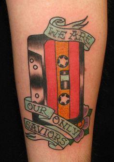 cassette tape tattoo with banners Cassette Tattoo, Cassette Tape, Get A Tattoo, Arm Tattoo, Grandma Tattoos, Americana Tattoo, Tattoo Banner, Christmas Tattoo, Traditional Tattoo Flash