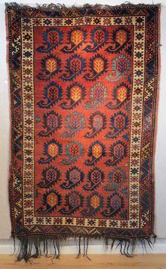 Kirghiz boteh-design rug, 19th century.