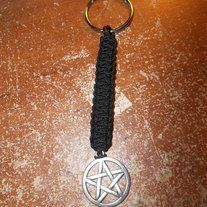 """Everyone has keys, but do they have a keychain that says """"HEY, this is me!"""" Well now you can, with this pentacle keychain. It is made up of Black micro-paracord, a tibetan silver pentacle and a silver plate key ring."""